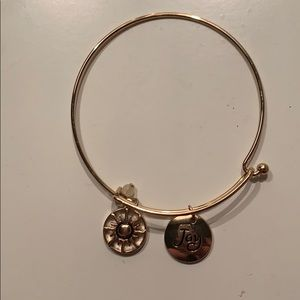 "Gold bracelet with ""joy"" charm"
